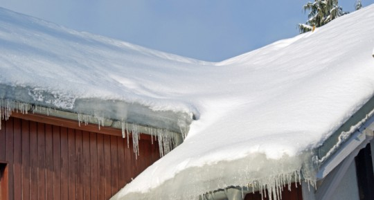 Winter weather causes dangerous ice dams protect your for Roof leaking in winter