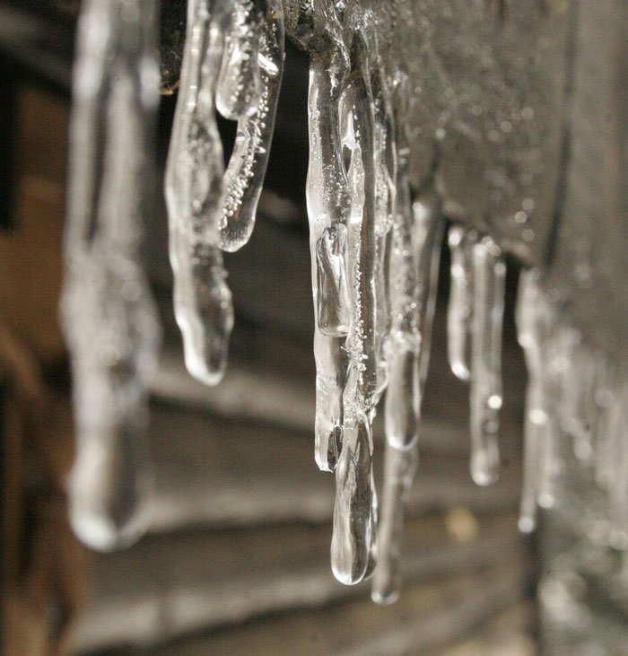 icicles hanging from ice dam on roof