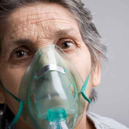 Senior woman with oxygen mask